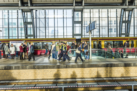 eduard: BERLIN, GERMANY - OCT 27, 2014: peope travel at Alexanderplatz subway station in Berlin, Germany. The station was built in 1882 by Johann Eduard Jacobsthal.