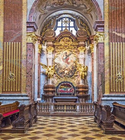 gold cross: MELK, AUSTRIA - APR 23, 2015: St. Peter and Paul Church in Melk Abbey in Melk, Austria. Abbey Church is considered one of the most beautiful in Austria, built in baroque churches.