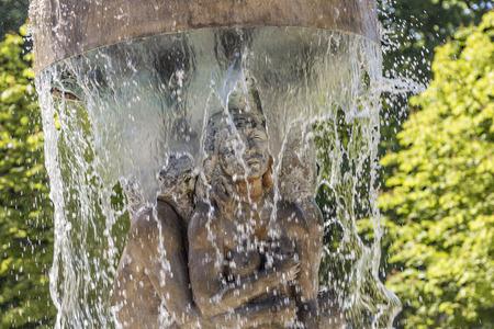 richard: BAD NAUHEIM, GERMANY - JUNE 4, 2015: fountain Adam and eve in paradise in Bad Nauheim, Germany. Artist Richard Hess created the fountain in 1980. Stock Photo