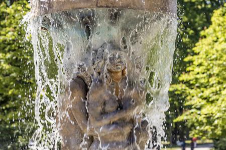 adam and eve: BAD NAUHEIM, GERMANY - JUNE 4, 2015: fountain Adam and eve in paradise in Bad Nauheim, Germany. Artist Richard Hess created the fountain in 1980. Stock Photo