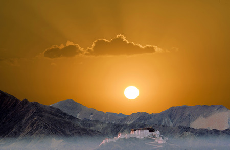 potala: potala in Lhasa in sunset with mountains Stock Photo