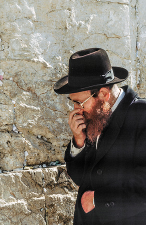JERUSALEM - JAN 1, 1994:  Orthodox jewish man prays at the Western Wall in Jerusalem, Israel. Israels annexation of East Jerusalem in 1967, including the Old City, was never internationally recognized. Editorial