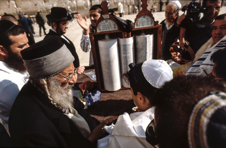 JERUSALEM - JAN 1, 1994: Orthodox jewish men pray at the Western Wall in Jerusalem, Israel. Israels annexation of East Jerusalem in 1967, including the Old City, was never internationally recognized.