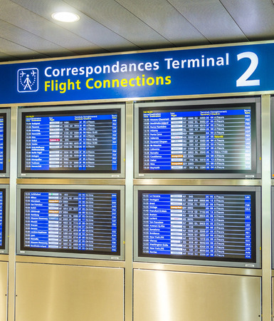 charles de gaulle: PARIS, FRANCE - JUNE 13, 2015: Charles de Gaulle  airport, hall of departures in Paris, France. A board with the schedule of departures of planes indicates latest infos.