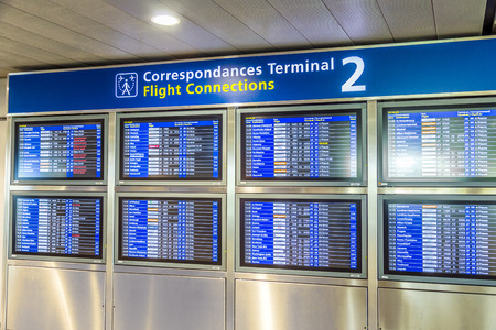 gaulle: PARIS, FRANCE - JUNE 13, 2015: Charles de Gaulle  airport, hall of departures in Paris, France. A board with the schedule of departures of planes indicates latest infos.
