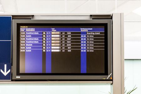 PARIS, FRANCE - JUNE 13, 2015: Charles de Gaulle  airport, hall of departures in Paris, France. A board with the schedule of departures of planes indicates latest infos.
