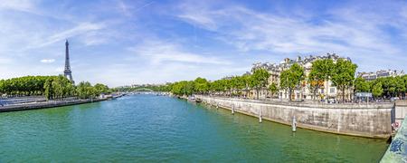 seine: Cityscape of Paris with view at Eiffel tower - the Seine river and residential buildings Editorial