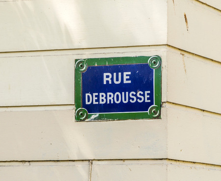rue: Paris, France - Rue Debrousse old street sign at vintage wall