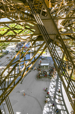 to prefer: PARIS, FRANCE - JUNE 10, 2015: people wait for the lift at the southern tower of the Eiffel tower in Paris, France. Most people prefer the lift instead climbing by stairs. Editorial