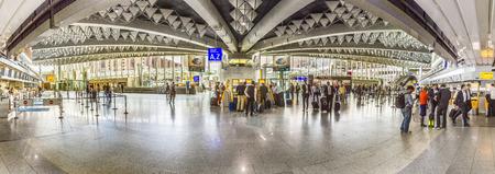 handled: FRANKFURT, GERMANY - JUNE 18, 2015: people at the Airport in the evening in Frankfurt, Germany. In 2012, Frankfurt handled 57.5 million passengers. Editorial
