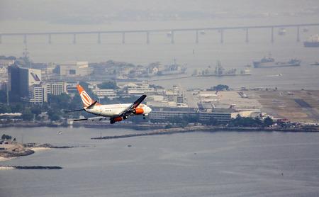 aircraft landing: RIO DE JANEIRO, BRAZIL - JAN 30, 2015: GOL Aircraft landing in Santos Dumont Airpot in Rio de Janeiro, Brazil. GOL became a world reference for democratizing air transportation in Brazil.