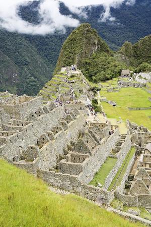 recline: Beautiful hidden city Machu Picchu in Peru. Machu Picchu is a 15th-century Inca site in the Cusco Region.