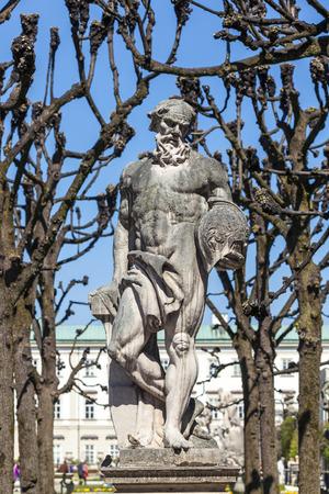 neptun: greek statues in Mirabell gardens in Salzburg under plane trees