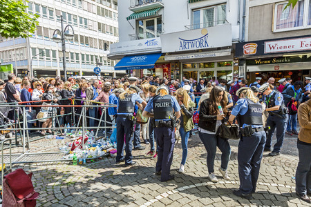 roemer: FRANKFURT, GERMANY - JUNE 26, 2015: people at the security check  for the visit of queen Elizabeth II at the Roemer market square in Frankfurt, Germany.