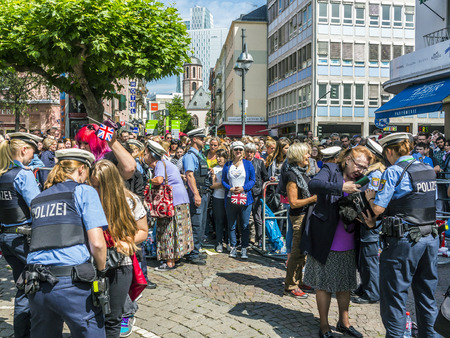 queen elizabeth: FRANKFURT, GERMANY - JUNE 26, 2015: people at the security check  for the visit of queen Elizabeth II at the Roemer market square in Frankfurt, Germany.