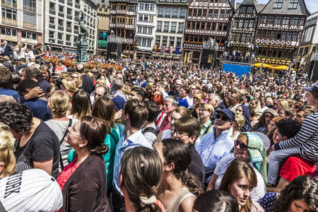 roemer: FRANKFURT, GERMANY - JUNE 26, 2015: people wait for the queen Elizabeth II at the Roemer market square in Frankfurt, Germany.