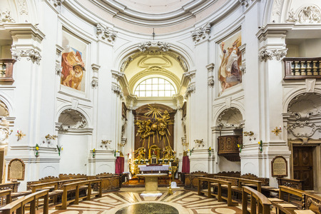 church tower: SALZBURG, AUSTRIA - APR 21, 2015: inside the Trinity-Church in Salzburg, Austria. The church was built between 1694 and 1702.