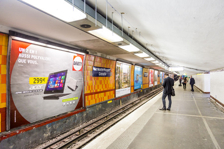france station: PARIS , FRANCE- JUNE 10, 2015: Tourists and locals on a subway train station in Paris, France. More than 30 million people visit Paris annually.