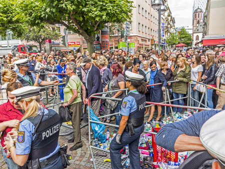 queen elizabeth ii: FRANKFURT, GERMANY - JUNE 26, 2015: people at the security check  for the visit of queen Elizabeth II at the Roemer market square in Frankfurt, Germany.