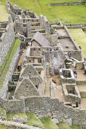 cusco region: MACCU PICHU, PERU - JAN 17, 2015: people visit Beautiful hidden city Machu Picchu in Peru. Machu Picchu is a 15th-century Inca site in the Cusco Region.