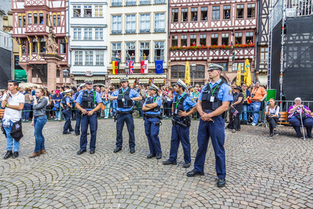 queen elizabeth: FRANKFURT, GERMANY - JUNE 26, 2015: police pays attention for the visit of queen Elizabeth II at the Roemer market square in Frankfurt, Germany.