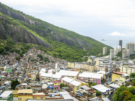RIO DE JANEIRO, BRAZIL - JAN 31, 2015: Mountain covered by poor houses - Favela in Rio de Janeiro, Brazil. Rio has an overall population of more than 7 mio people.