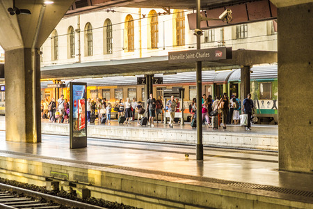 france station: MARSEILLE, FRANCE, JULY 10, 2015: people at Saint Charles train station in Marseille, France. Station opened in 1848
