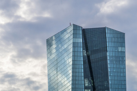 central europe: FRANKFURT, GERMANY - JULY 17, 2015: Short time after opening of new headquarters of European Central Bank in Frankfurt, Germany. Dark cloud over building.
