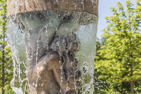 eve: BAD NAUHEIM, GERMANY - JUNE 4, 2015: fountain Adam and eve in paradise in Bad Nauheim, Germany. Artist Richard Hess created the fountain in 1980. Editorial