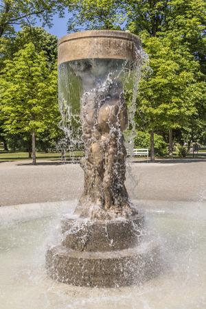 adam and eve: BAD NAUHEIM, GERMANY - JUNE 4, 2015: fountain Adam and eve in paradise in Bad Nauheim, Germany. Artist Richard Hess created the fountain in 1980. Editorial
