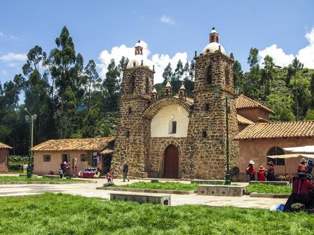 san pedro: RAQCHI, PERU - JAN 19, 2015: people visit the church San Pedro de Cacha in Raqchi, Peru. The church of Raqchi is placed near the incan temple of Wiracocha.