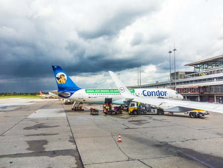HAMBURG - GERMANY - JULY 29, 2015: Condor Aircraft at the gate in Terminal 2 in Hamburg, Germany. Terminal 2 was completed in 1993 and houses Lufthansa and other Star Alliance partners. Editorial