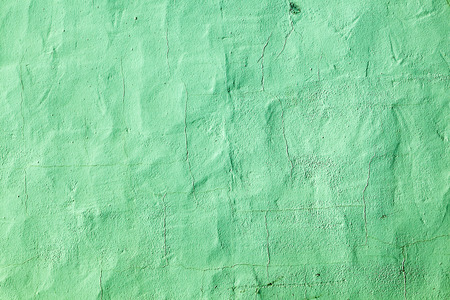 green painted old concrete wall in harmonic color