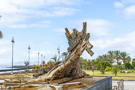 sunken boat: remains of old phoenician shipwreck in a park in Arrecife Stock Photo