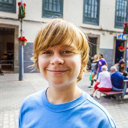 walking zone: smart boy enjoys walking in the pedestrian zone