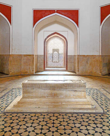 commissioned: DELHI, INDIA - NOVEMBER 15, 2011: marble tomb inside  Humayuns tomb in Delhi, India. The tomb was commissioned by Humayuns first wife Bega Begum in 1569.