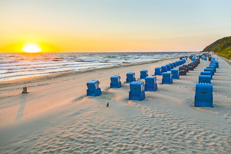 moon chair: beach chairs in morning light at the baltic sea