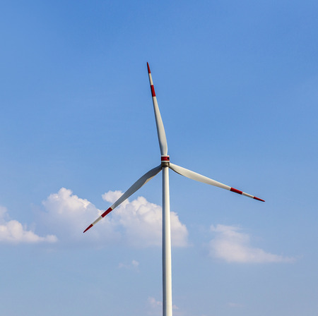 rural area: windmill in rural area under blue sky