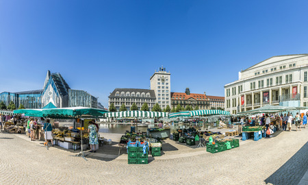privileges: LEIPZIG, GERMANY - AUG 8, 2015: Old Town Hall in Leipzig with people at marketplace. In about 1165, Leipzig was granted municipal status and market privileges.