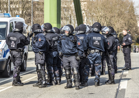 riots: FRANKFURT, GERMANY - MAR 18, 2015: police pays attention for people demonstrate against EZB and Capitalism in Frankfurt, Germany. 9 tsd policemen guard the demo.
