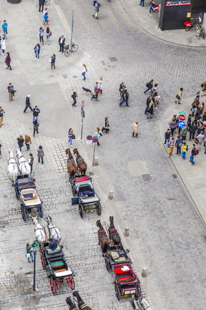 stephansplatz: VIENNA - APR 24, 2015: aerial of crowded Stephansplatz in Vienna, Austria with fiakers. Severalpopular pedestrian routes begin here and a lot of tourists visit this place.