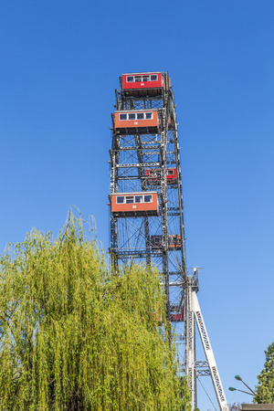 big wheel: VIENNA, AUSTRIA - APR 25, 2015: A view of the Wiener Riesenrad in Prater from outside the park. The big wheel was constructed in 1897 by the English engineer  Walter Bassett