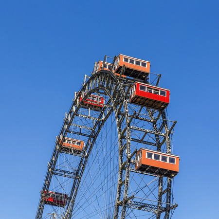 low angles: VIENNA, AUSTRIA - APR 25, 2015: A view of the Wiener Riesenrad in Prater from outside the park. The big wheel was constructed in 1897 by the English engineer  Walter Bassett