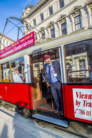 electric tram: VIENNA, AUSTRIA - APR 25 2015: conductor at old red vintage tram operating in Vienna.   On January 28, 1897, an electric tram operated for the first time in Vienna on the tracks of todays line 5. Editorial
