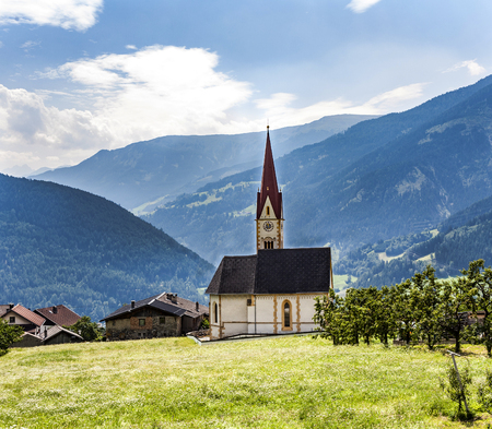 grins: famous church Saint Peter and Paul in Stanz, Austria Stock Photo