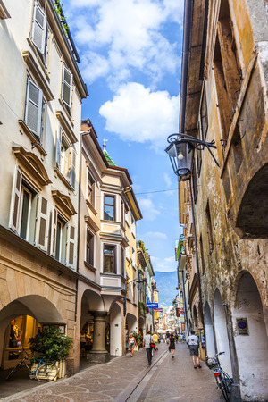 meran: MERAN, ITALY - AUG 1, 2015: people walk at central shopping street in Meran, Italy. Meran was first mentioned in an 857 and nowadays  best known for ist SPA resorts.