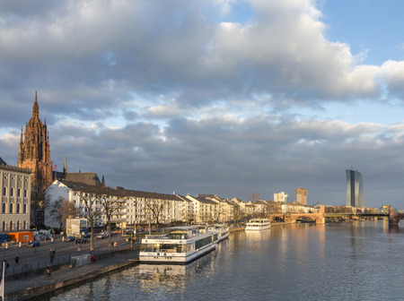 river main: FRANKFURT, GERMANY - FEB 22, 2015:: river Main with boats and view to the new seat of the European Central Bank in Frankfurt, Germany.  A 185 165-metre-twin-skyscraper located east of the city centre. Editorial