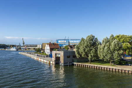 dockyard: WOLGAST, GERMANY - AUG 13, 2015: view at river Peene to dockyard area in Wolgast. The Peene dockyard was founded in 1948 by the russian troups. Editorial