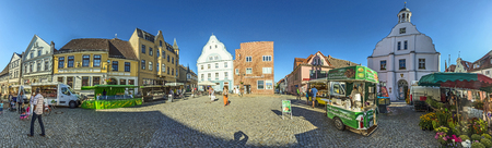 market place: WOLGAST, GERMANY - AUG 13, 2015: people at market place with old town hall in Wolgast, germany. Most houses of the Old Town therefore date back to the 18th and 19th centuries.