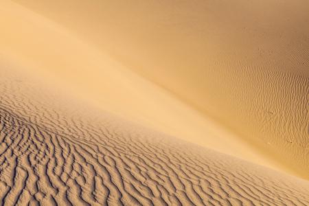 sand texture: beautiful sand dune in sunrise in the desert